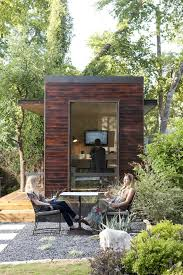 austin wooded backyard shed modern with boulders sheds