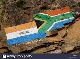 Afican Flag Painting On A Rock Face Depicting New And Old South African Flags