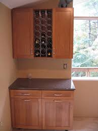 what s in your wine liquor cupboard the bottom cabinet is a large pull out recycling center there also now is a mini fridge next to the lower cabinet the mostly functions as a beer fridge