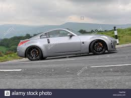 nissan 350z brembo brakes sports car driving on empty twisting mountain roads nissan 350z