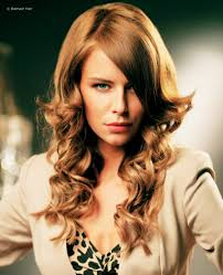 layered extensions curly hairstyle created with hair extensions and hairpieces