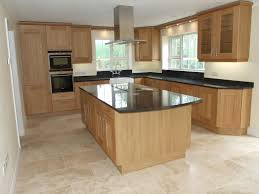 granite countertop white kitchen cabinets with butcher block