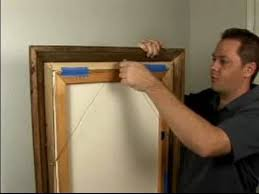 how to hang a picture how to hang pictures with a wire hanger
