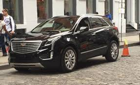 cadillac suv images gm s cadillac attacks tesla with best selling suv tesla