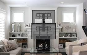 amazon com mantelmount mm540 pull down tv mount above fireplace