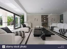 huge modern kitchens black white throws on white sofas in large modern white living