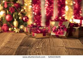 Red Gold And Purple Christmas Tree - christmas background christmas tree on wooden stock photo