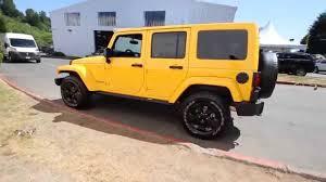 yellow jeep wrangler unlimited 2015 jeep wrangler unlimited altitude edition baja yellow