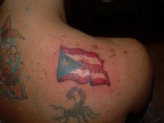 puerto rican flag with coqui and lilies tattoo nephtali