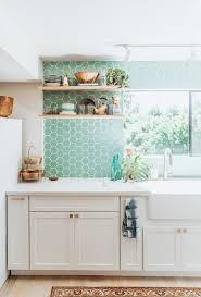 white kitchen cabinets with aqua backsplash airy aqua kitchen backsplash transitional kitchen