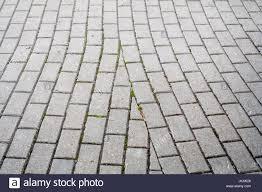 gray stone tile city road background texture city stock photo