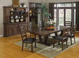 dark rustic dining table round dark brown wooden table and white cup cream chairs with