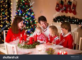 big family three children celebrating christmas stock photo