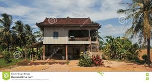 a small house with coconut trees in kampot cambodia stock photo