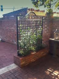 more gardens 28 a raised planter with custom iron trellis