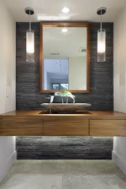 bathroom stacked stone tile backsplash and floating vanity with