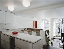 minimalist kitchen with white kitchen island and dining table for