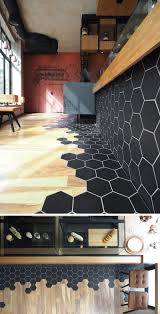 Black Laminate Flooring Tile Effect Hexagon Tiles Transition Into Wood Flooring Inside This Cafe In