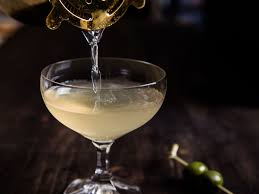 martini glass with olive olive brine mezcal u003d your new favorite martini serious eats