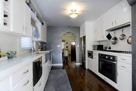 1947 bungalow gets an age appropriate update tbo com original kitchen cabinets and red formica countertops were replaced with a pristine white version topped with