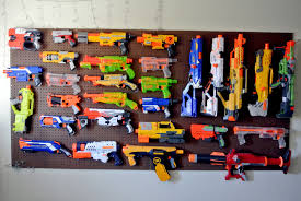 nerf bedroom my husband hangs his nerf guns armory style in our bedroom guns