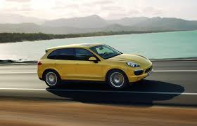 2011 Porsche Cayenne S - 2011 yellow porsche cayenne s profile driving eurocar news