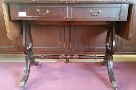 dark wood drop leaf table dark wood drop leaf desk 2 drawers brass claw feet tables for sale