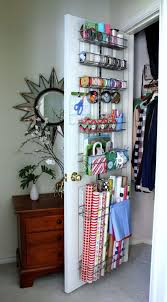 container store christmas wrapping paper organized craft or gift wrap on the back of a door diy ideas