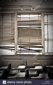 old classroom with broken window blinds stock photo royalty free