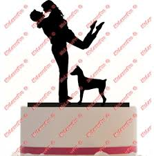 custom wedding cake topper of husband carrying wife with a dog