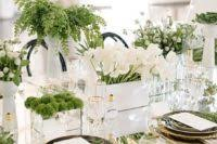 picture of emerald table runner and tall vases with olive branches