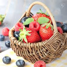 fruit basket fruit basket with strawberries and blueberries stock photo