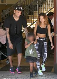 matching shoes for him and karrueche and chris looked happier than as they headed to the