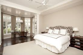 Chandelier In Master Bedroom Modern Master Bedroom With Built In Bookshelf U0026 Carpet In