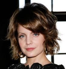short layered medium length hairstyles short layered wavy with bangs women medium haircut