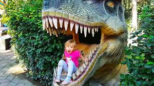 Kids Outdoor Entertainment - bad kids in dinopark amusement park entertainment for kids outdoor