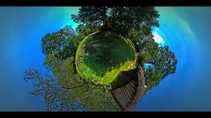 little tiny planet 360 degree view on backyard of rustic houses in