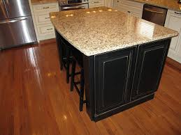 oak kitchen cabinets with dark island kitchen as well as