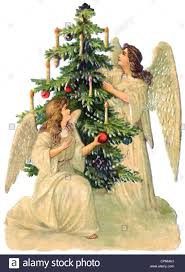 christmas tree angel christmas christmas angel two decorating the christmas