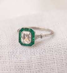 art deco platinum 85 carat diamond and emerald engagement ring by