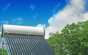 solar water heating system on the roof of a house on a background