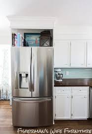 kitchen cabinets refrigerator surround round designs