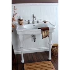vintage white vanity combo sink on brown harwood floor also wooden
