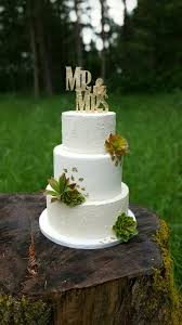 rustic succulent wedding cake with gold leaf and different