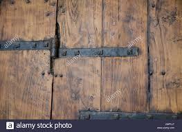 medieval wood door with metal decorations vintage look stock photo