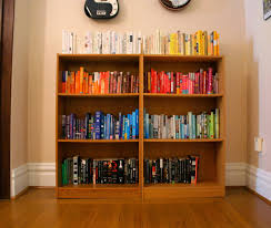 color coded bookshelves the surznick common room