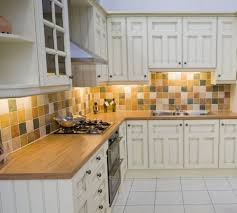 vibrant classic kitchen with off white cabinet and mosaic