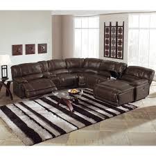 small leather sofa and circle chair as well queen size bed