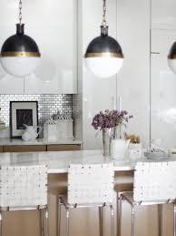 kitchen kitchen island white wall cabinets electric range hood