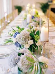 table centerpieces with candles seaside island destination wedding with blue u0026amp white décor